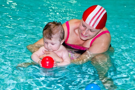 Young family with baby having fun in the swimming pool Stock Photo - 13413575