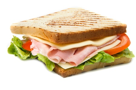 big sandwich with ham, cheese, tomatoes and salad on toasted bread  Stock Photo - 13417289
