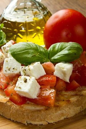 italian bruschetta with fresh tomatoes  photo