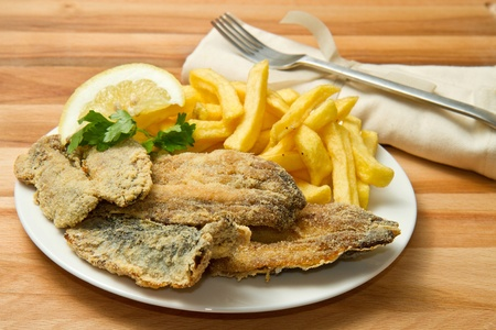 a dish with sardines fried and potate Stock Photo - 13486943