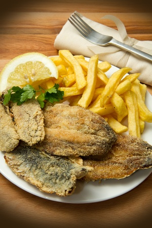 a dish with sardines fried and potate photo