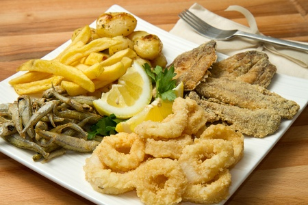 a dish with different fish fried and potate photo