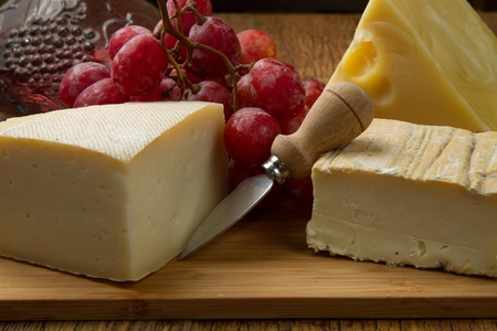 different cheese and  rose grapes  photo