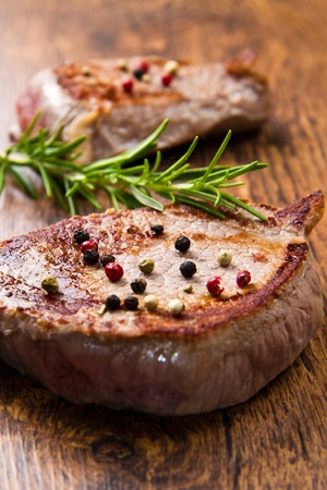 grilled meat fillet on wooden background photo