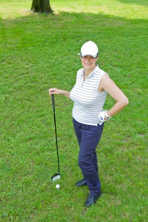 tee off: An image of a young female golf player