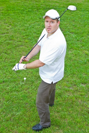 An image of a young male golf player  photo