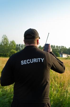 bodyguard: parte trasera de un guardia de seguridad Foto de archivo