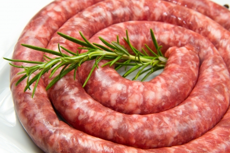 fresh raw sausage with rosemary on white dish Stock Photo - 13826142