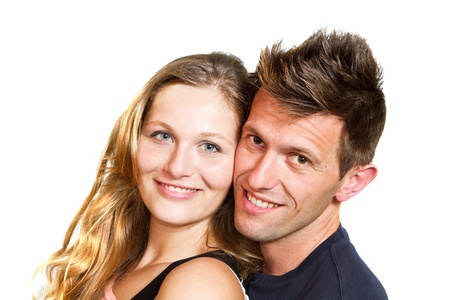 Portrait of a beautiful young happy smiling couple photo