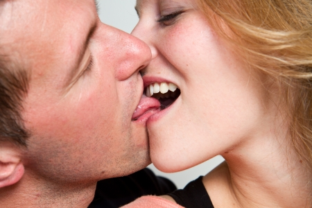 close up portrait of young caucasian couple kissing Stock Photo - 13926954