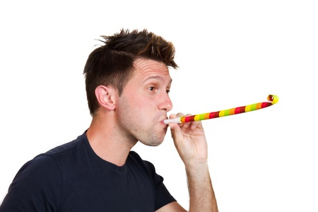 blowers: Man playing with party blowers