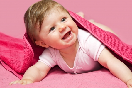 nude baby: An adorable, laughing baby looking at camera