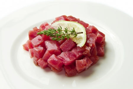 tuna tartare with fresh salad and lemon slice photo
