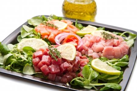 salmon, tuna and swordfish tartare with fresh salad photo