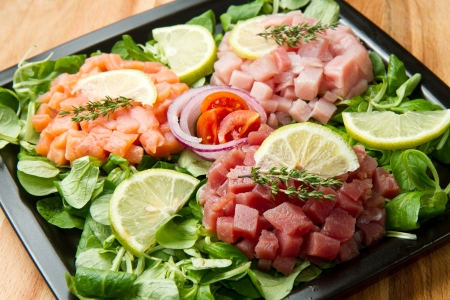 salmon, tuna and swordfish tartare with fresh salad photo