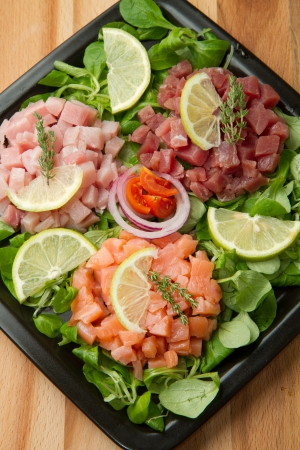 salmon, tuna and swordfish tartare with fresh salad Stock Photo - 14300840