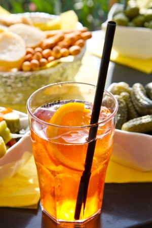 aperitif: Long-drink with orange slices  Stock Photo