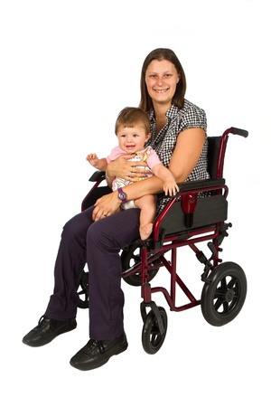 A smiling girl with a baby  in a wheelchair   photo