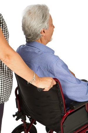 Mature man in his wheelchair Stock Photo - 14422903