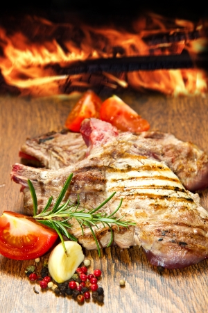 Grilled meat on wooden table Stock Photo - 14457622
