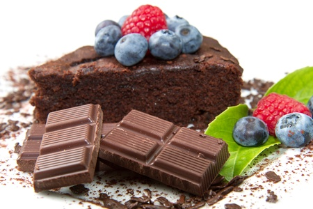 Piece of chocolate cake with fresh berry on white background  photo