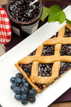 blueberry tarts on wooden table photo