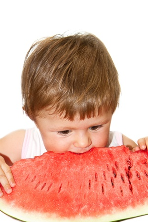 Sweet little girl eating a slice of watermelon on white background  Stock Photo - 14712170