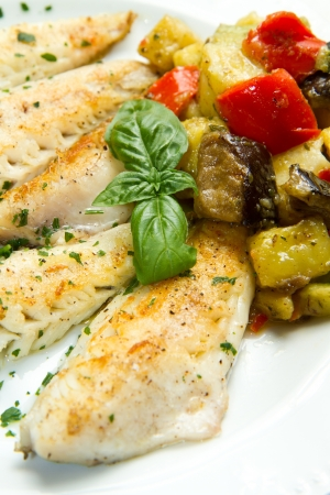 grilled fish: Tasty healthy fish fillet with vegetables
