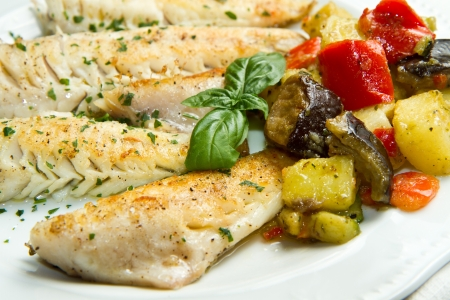 Tasty healthy fish fillet with vegetables photo