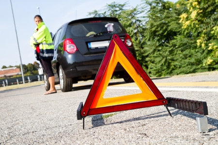 Broken down car with red warning triangle  Stock Photo