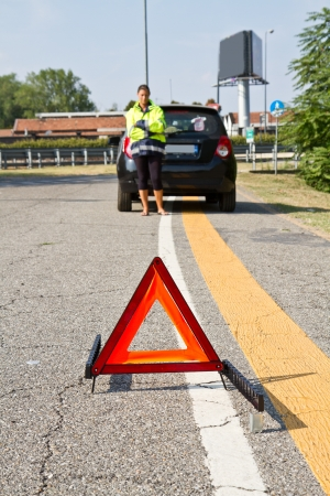 car trouble: Broken down car with red warning triangle  Stock Photo