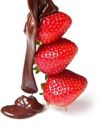 strawberries and chocolate on a white background  photo