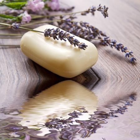 lanvander soap with flower on wooden background photo