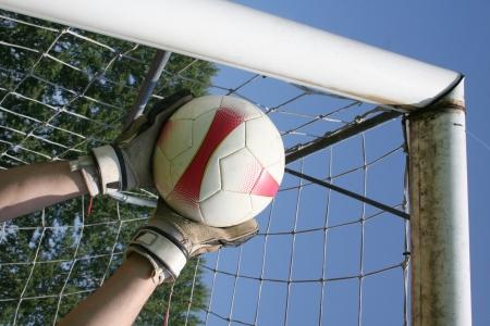 portero: Fútbol portero de fútbol haciendo ahorrar Foto de archivo