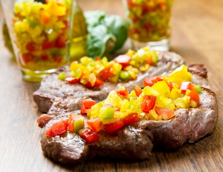 Grilled Steak Meat with cut vegetables photo