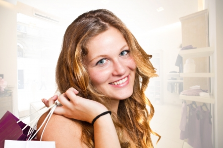 Smiling girl with shopping bags Stock Photo - 14959073
