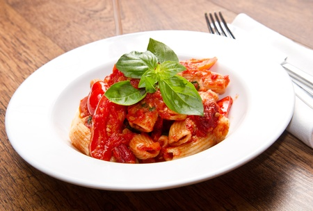 pasta with tomatoes and basil photo