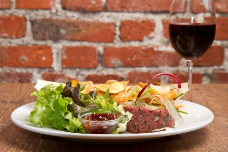 steak tartare:  raw ground beef with chips and salad
