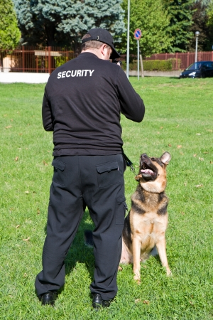 back of a security guard with a dog