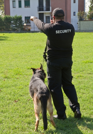 back of a security guard with a dog Stock Photo - 15261356