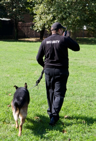 back of a security guard with a dog photo