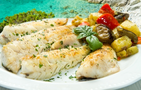 Tasty healthy fish fillet with vegetables Stock Photo - 16032250