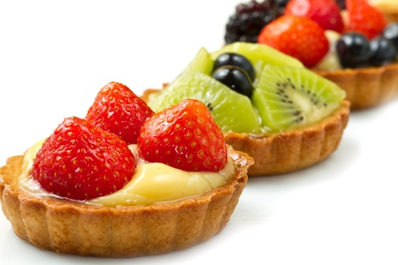 Fresh fruit tart on white background photo