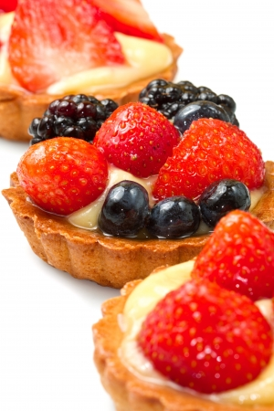 Fresh fruit tart on white background photo