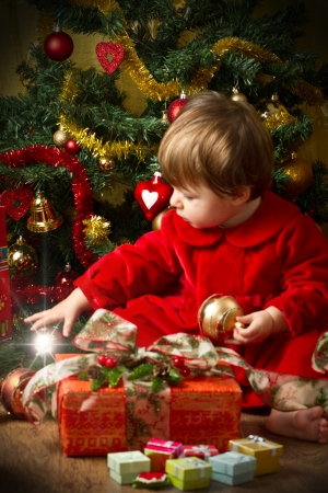 baby play with present box at Christmas tree Stock Photo - 16010378