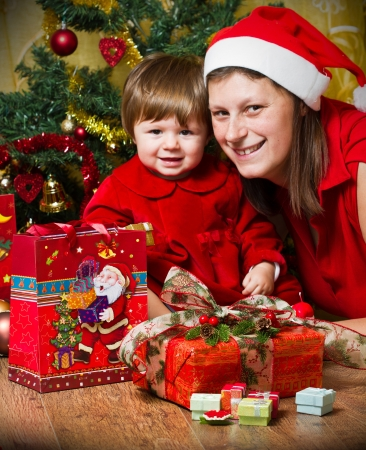 Young mother with  baby  at Christmas tree Stock Photo - 16010376