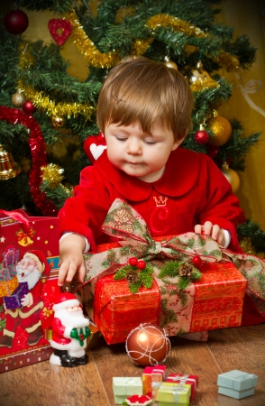 baby play with present box at Christmas tree Stock Photo - 16010375