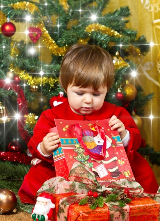 baby play with present box at Christmas tree Stock Photo - 16010374