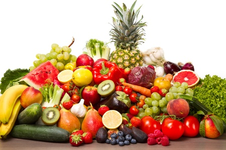 Fruits and vegetables like tomatoes, zucchini, melons, bananas and grapes arranged in a group photo