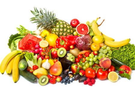 Fruits and vegetables like tomatoes, zucchini, melons, bananas and grapes arranged in a group Stock Photo